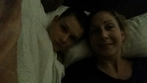 Cuddling with mommy in the dark while she has a migraine... #chronicillnessparenting